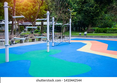 Colorful rubber flooring for Children run.climbing rope  at playground ,exercise kid,activities in outdoor public park surrounded by green trees at sunlight morning.