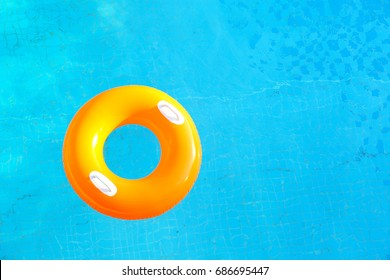 Colorful rubber ring floating in pool