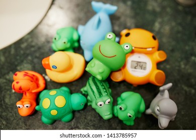 Colorful rubber toys on sink, ready for baby to play in bathtub