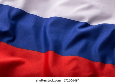Colorful Russia flag waving in the wind.