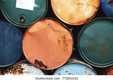 Colorful rusty oil barrel stack in rows