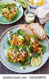 Colorful salad with fresh lettuce, couscous and vegetables