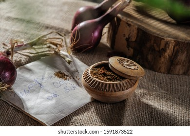 Colorful salt and Red onion on hemp cover and wooden mat