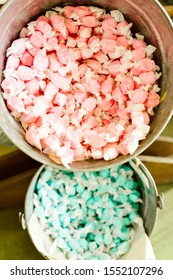 Colorful salt water taffy candy in aluminum buckets for sale