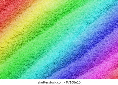 Colorful sand as the background image with wave-shaped structure.
