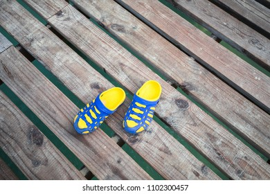 Colorful sandals on wooden walkway