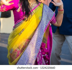 Colorful sari of silk and lace worn by guest of a wedding