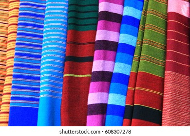 Colorful sarongs on sale in the market.Sarongs for women.Cloth for women.