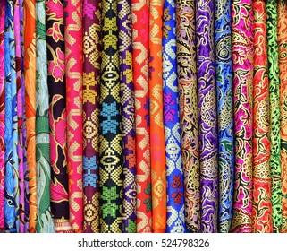 Colorful sarongs for sale at the art and craft market of Ubud Bali Indonesia