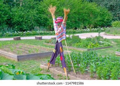 Colorful scarecrow in the garden.