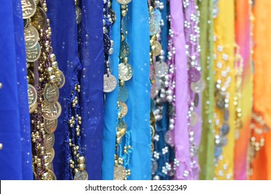 Colorful scarfs with coins for belly dancing
