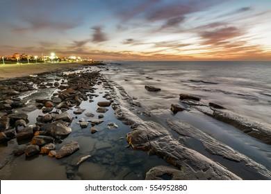 Colorful scene after sunset along the coastline of Nahariya, long exposure