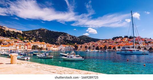 Colorful scenery in mediterranean town Hvar, famous travel place on Adriatic Sea, Croatia. Amazing Hvar city on Hvar island, Croatia. View of the Hvar town, Dalmatia, Croatia.