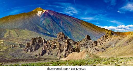 Colorful scenic landscape of sunset in Tenerife national park of Teide.Alto de Guajara.Canary island.Volcano Teide with Llano de Ucanca.Desert panorama