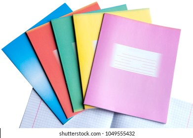 colorful school notebooks on white background