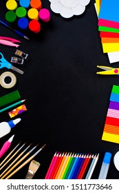Colorful school supplies as a border on the blackboard