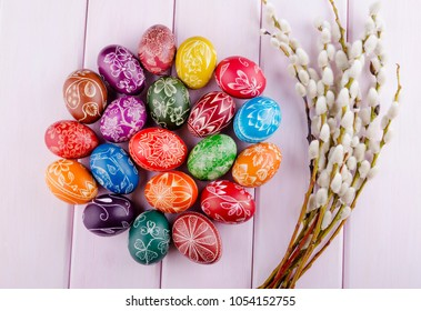 colorful scratched handmade Easter eggs on a wooden table