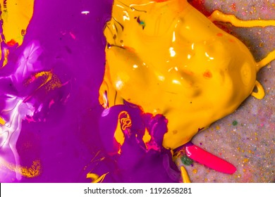 colorful of screen printing ink dropped on the ground made an abstract art