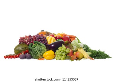 Colorful and seasonal selection of autumn fruits and vegetables including  squashes, pumpkin, grapes and a lot more