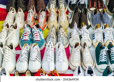 Colorful of second hand shoes for sale at street flea market.