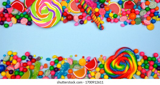 Colorful selection of candies. Top view double border with a blue banner background.