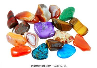 Colorful semi-precious stones against white background