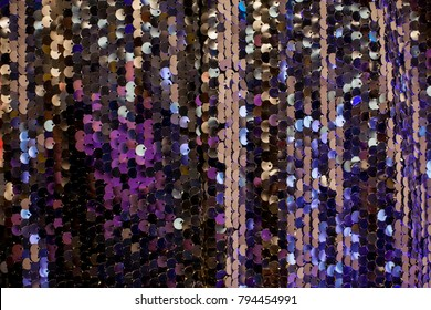 Colorful sequins - sparkling textile. Sequins on Fabric, Sequins or Beads. sequin BACKGROUND. colorful glitter surfactant. Fashion fabric. Sparkle Glitter Background closeup. soft focus