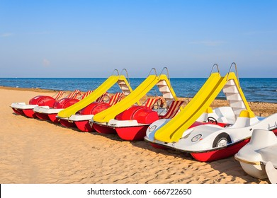 Colorful series of pedalo parked on the beach. Bibione Italy