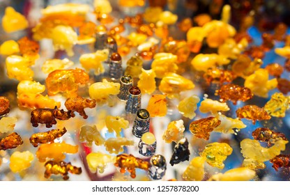 Colorful set of amber - a collection of animal figurines - a typical souvenir from Gdansk, amber workshops in Mariacka Street in Old Town in Gdansk Poland - shallow depth of field