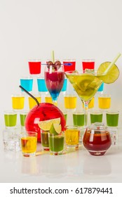 Colorful set of drinks, color drink decorated with fruit, many color kamikaze drink, shot drinks, party set