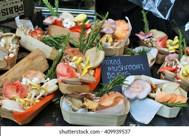 A colorful set of mixed mushrooms in small baskets in a market in London