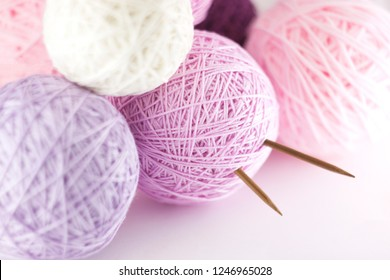 Colorful set of yarn ball, shades of pink, on white background with space for text, soft light.