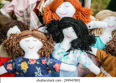 colorful sewed handmade dolls on a fair