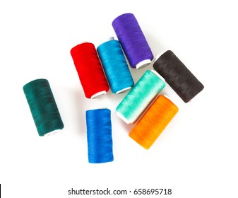 colorful sewing thread isolated on white