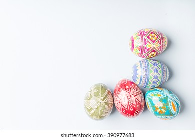 colorful shiny easter eggs on blue background