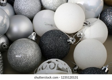 Colorful, shiny and glittery black, white, grey and silver Christmas decorations. Merry Xmas!