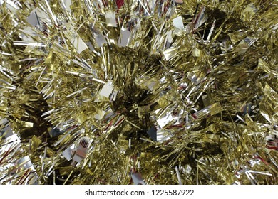 Colorful, shiny and glittery gold colored Christmas decorations. Merry Xmas!