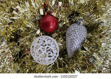 Colorful, shiny and glittery gold, red and silver colored Christmas decorations. Merry Xmas!