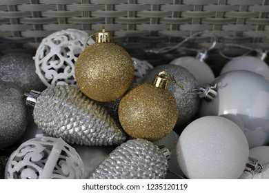 Colorful, shiny and glittery gold, white and silver colored Christmas decorations. Merry Xmas!