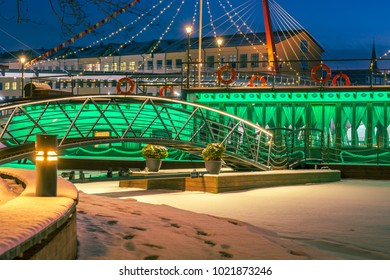 Colorful ship with festive lights frozen in river. Restaurant on water at winter. Atmospheric feeling in city Jelgava at Christmas time.