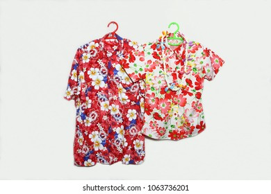 Colorful Shirt and Garland symbolic of Thailand Songkran festival or Water festival in South East Asia Region in isolated on white background