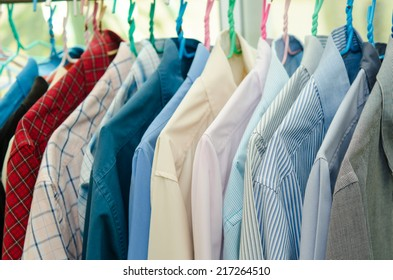 colorful shirt rack on hanger in a row