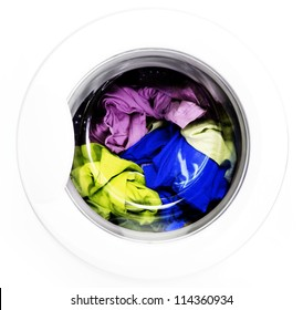 Colorful shirt and trousers in a white laundry.