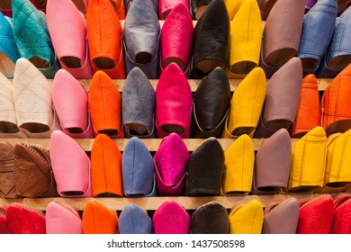 Colorful shoes in a market shop in a souk in Morocco. Those kind of slippers are called babouches.