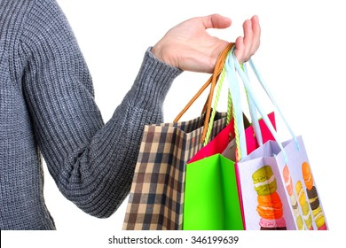 Colorful shopping bags for shopping in the hand of the woman isolated on white background
