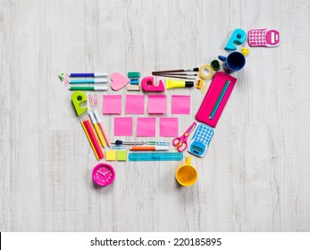 Colorful shopping cart composed of stationery and office objects.