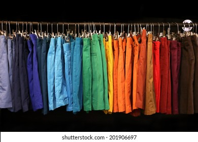 colorful shorts hanging on a rack