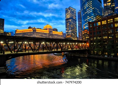 Colorful shot of Chicago city night lights on November evening reflecting its view on the Chicago River.