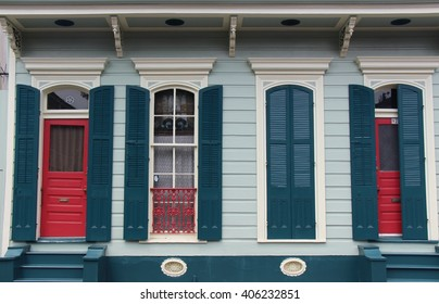 colorful shutters windows and doors with molding on Bourbon street in the French Quarter, New Orleans