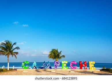 Colorful sign in Campeche, Mexico with the Gulf of Mexico in the background